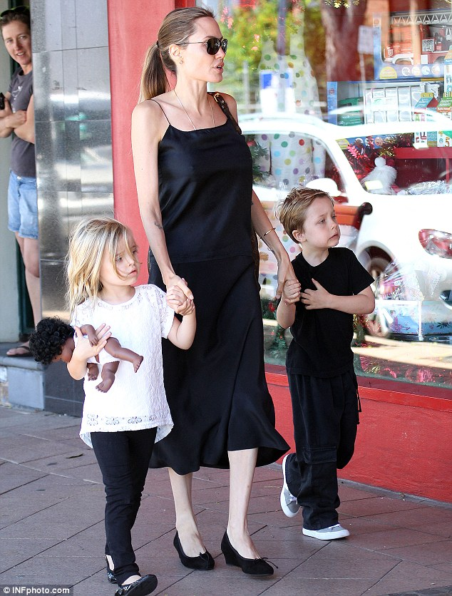 Working hard: Angelina Jolie, seen here with twins Vivienne and Knox last week, will mark Thanksgiving in Australia with her six children