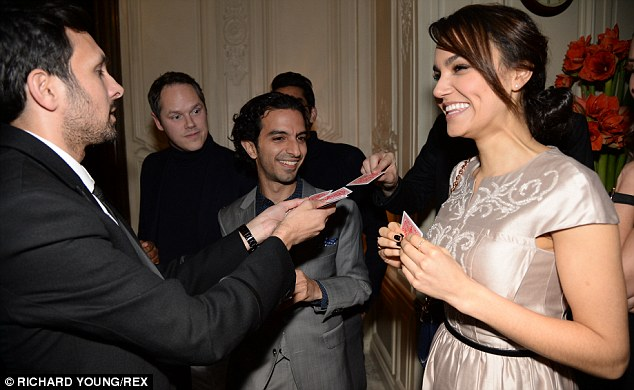 Magician's trick: Magician Dynamo amused Samantha with a card trick