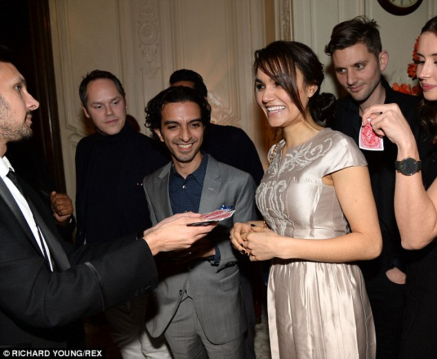 Crowd pleaser: Dynamo wows Samantha with his magical card tricks