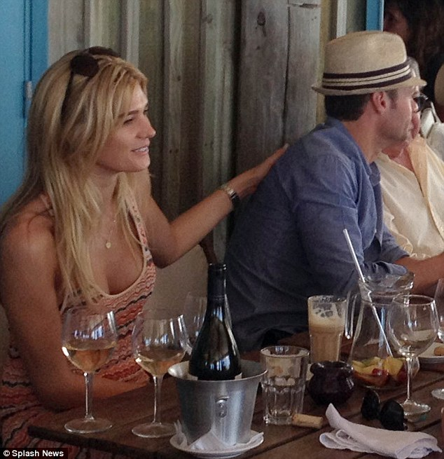 Hands on: The blonde was touchy-feely during a boozy lunch with friends