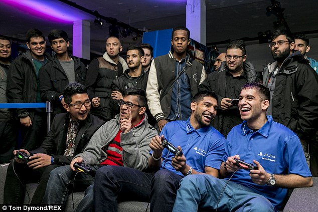 All smiles: Amir Khan has a laugh while playing at the PlayStation Lounge in Covent Garden
