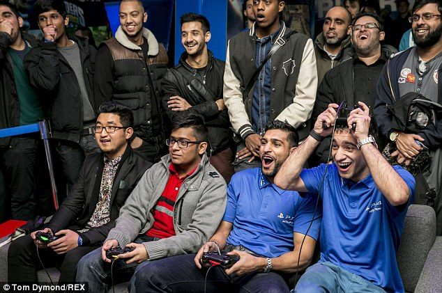 At the controls: Amir Khan gets to grips with the PlayStation 4 at the Playstation Lounge in Covent Garden