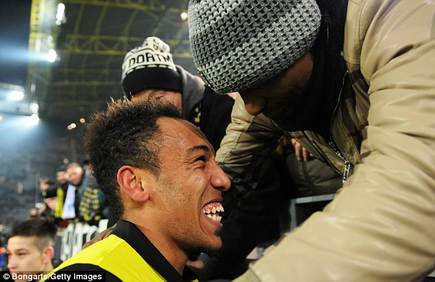 All smiles: Aubameyang celebrates with the Dortmund supporters following his goal against Napoli