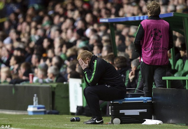 Can't look: Celtic manager Neil Lennon covers his face during the 3-0 defeat at home to AC Milan