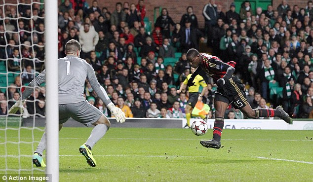 Icing on the cake: AC Milan's Mario Balotelli scores past Fraser Forster to seal the win for the visitors