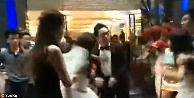 Love triangle: At one point, the bride even turns on her new husband and pushes him away