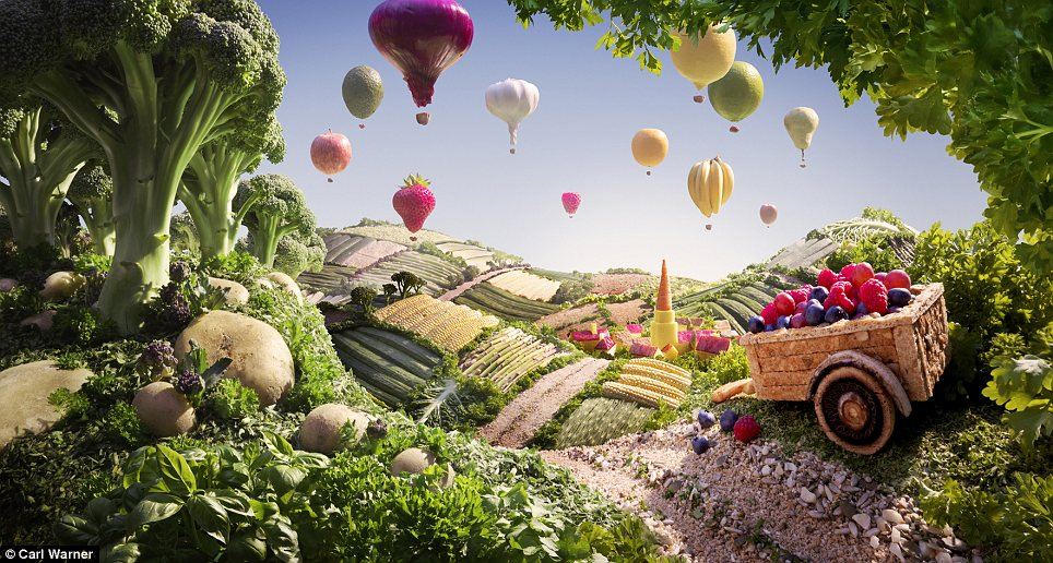 The sky's the limit: For this countryside scene Mr Warner used a variety of fruits to make balloons