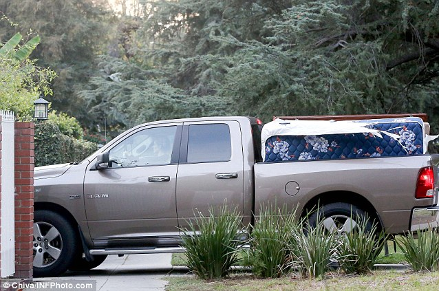 Nice ride: Kristen jumped in her pick-up truck to get the bed from a residential area of Los Angeles