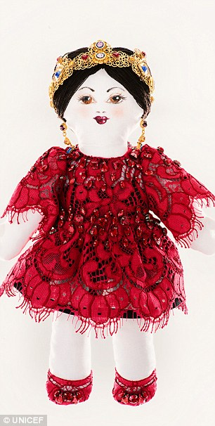 Big money: Each of the stylish dolls by Dior (L) and Dolce & Gabbana (R) are expected to raise an estimated grand total of 200,000 euros (£166,000)