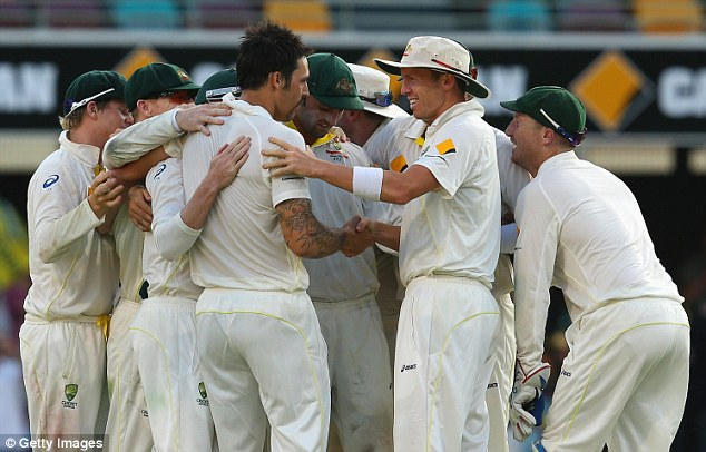 On the march: Australia celebrate as they head for victory over England in the first Test in Brisbane
