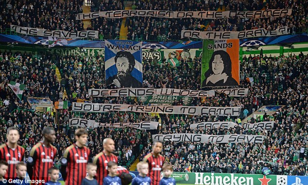 Investigation: UEFA are looking into the banner displayed by Celtic fans before their side's clash with AC Milan