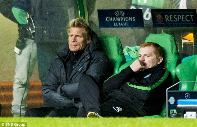 Down and out: Celtic boss Neil Lennon (right) and assistant Johan Mjallby look on at Celtic Park during the loss