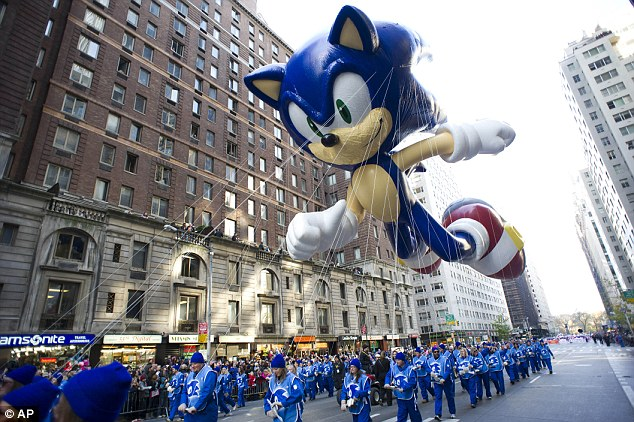 High winds: Handlers keep a tight rein on the Sonic the Hedgehog balloon as it travels the route of the Macy's Thanksgiving Day Parade in New York last year
