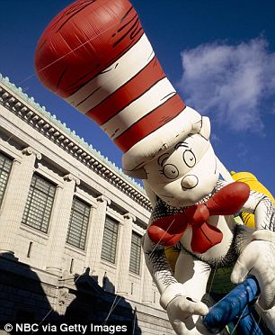 Dangerous cat: The Cat in the Hat was the culprit when winds whipped the balloon so hard it topped a lamp post, which in turned seriously injured a woman