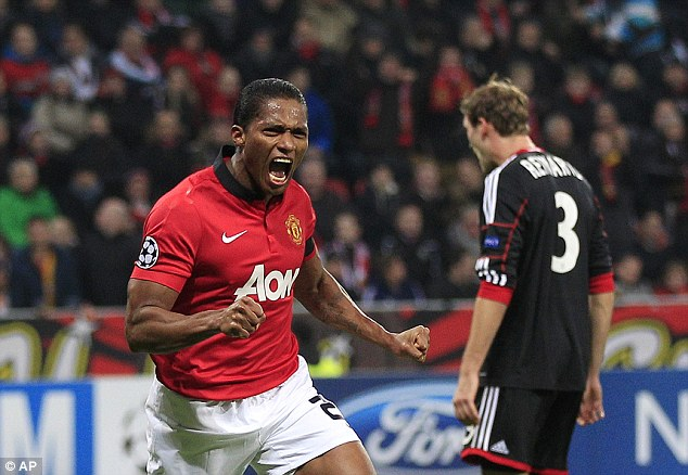 Delight: Antonio Valencia celebrates putting United ahead in the first half