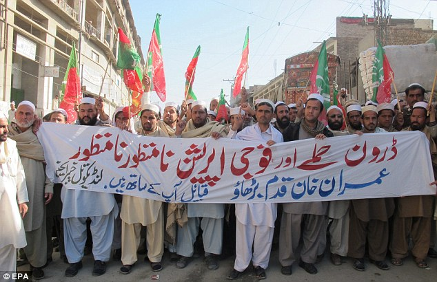 Backlash: Supporters of opposition political party Pakistan Tehrik-e-Insaf carry a banner reading in Urdu 'No to Drone attacks and Military operation' during a protest against the US drone strikes in Khyber