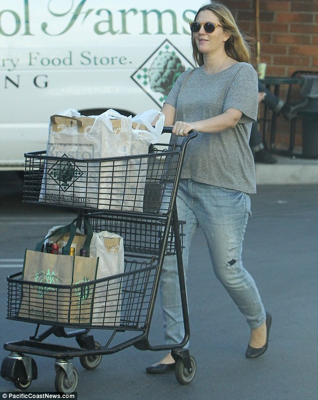 Trolley dolly: Drew looked wonderful despite adopting a dressed down ensemble for her supermarket sweep