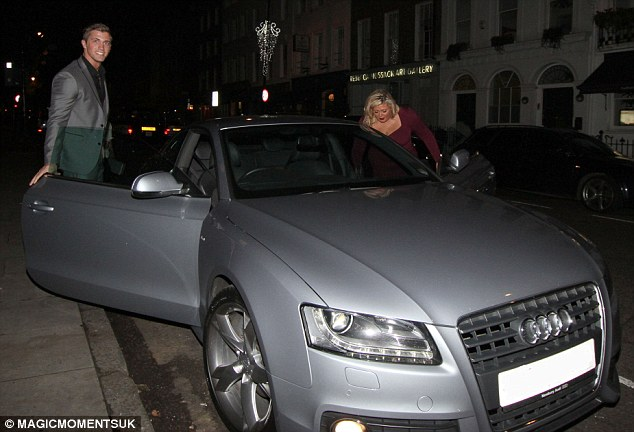 We're off: The pair climb into Dan's silver Audi after a night out at a local London restaurant on Wednesday evening