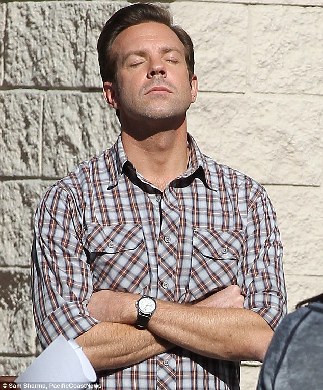 So bored: Jason looked like he wanted to fall asleep as he waited for another scene to be set up