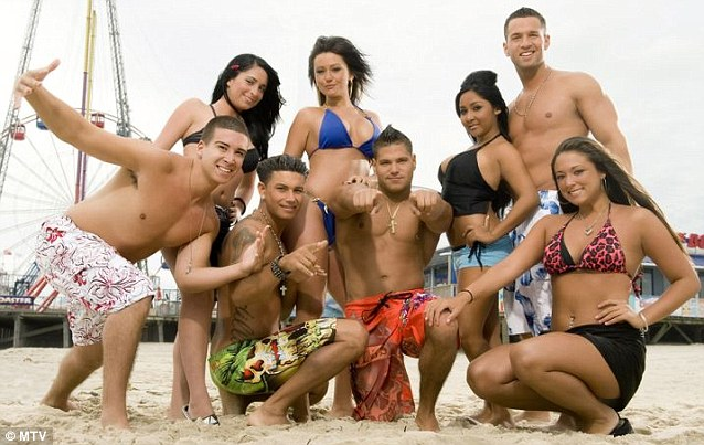 Reality stars: Pauly D and the cast of MTV's Jersey Shore posed for a group shot with the famed boardwalk in the background