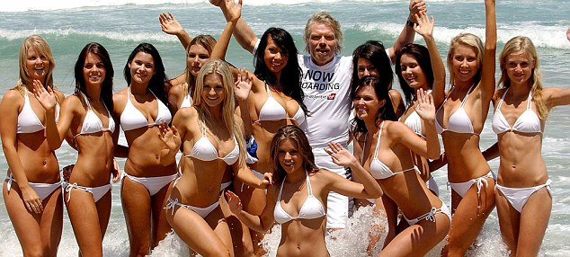 Perks: Billionaire Sir Richard Branson surrounded by bikini-clad girls in Australia