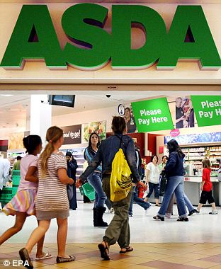 Customers at an ASDA supermarket in London, 15 August 2007.