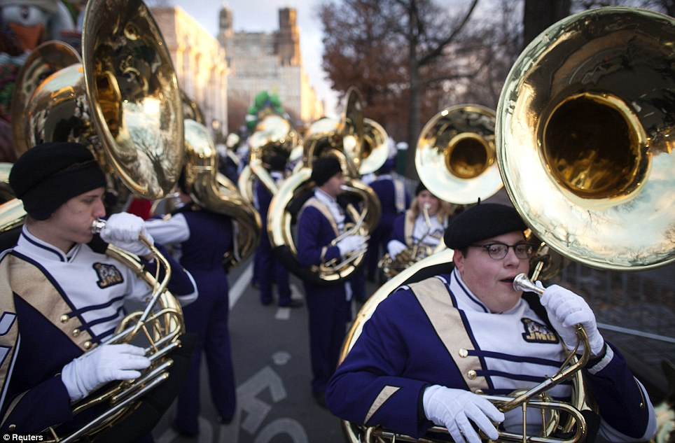 Warming up: A few high school marching bands get the opportunity to march in the parade each year. Above, musicians in a marching band warm up