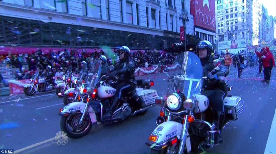 Motorcade: Officers from the NYPD ride down the streets of New York, clearing the way for the parade