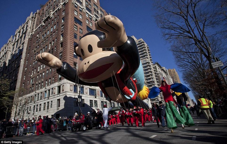 Jet-pack: Julian the Sock Monkey rockets down Central Park West