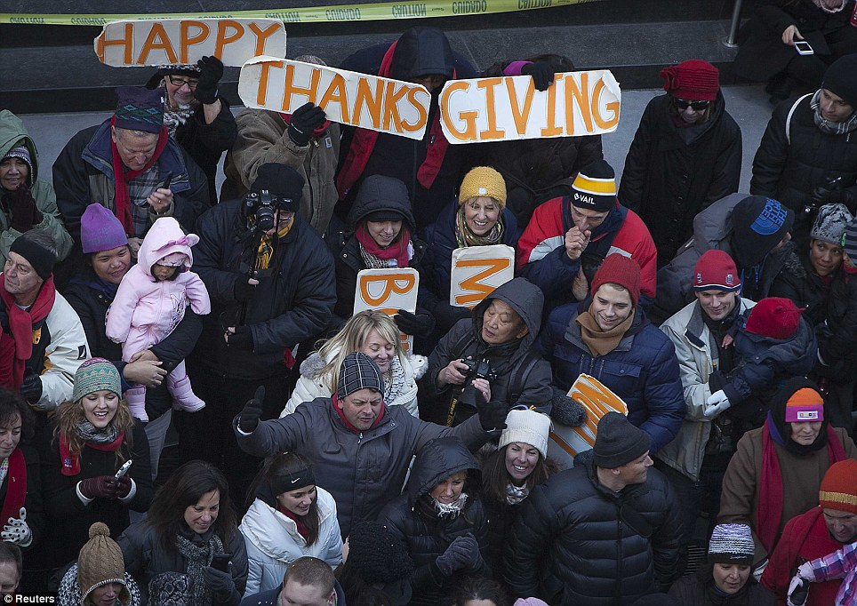 Happy campers: Millions of spectators spent their Thanksgiving morning out in the cold to catch a glimpse of the Macy's spectacular