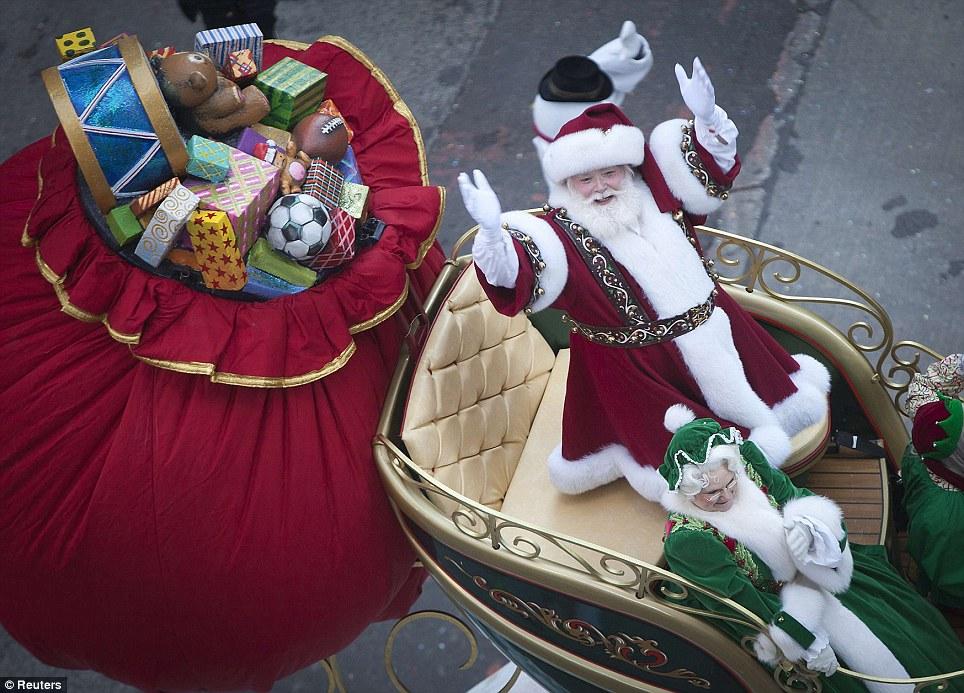 Season's Greetings: Santa makes his way down Sixth Avenue with Mrs Claus