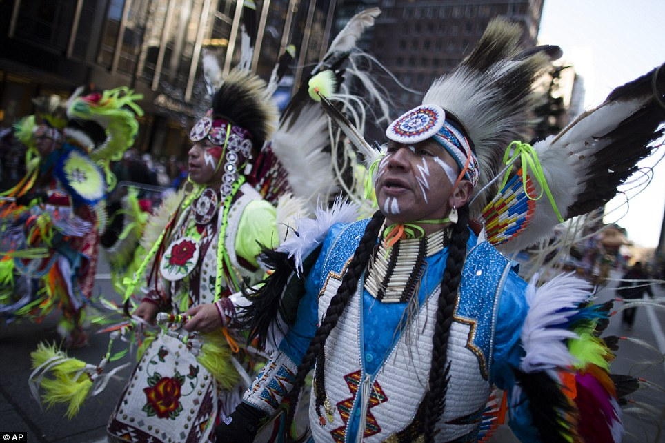 An American holiday: Members of the Oneida Nation of New York march in the parade. The American tradition of Thanksgiving dates back to the harvest feast between Pilgrims and Native Americans in 1621