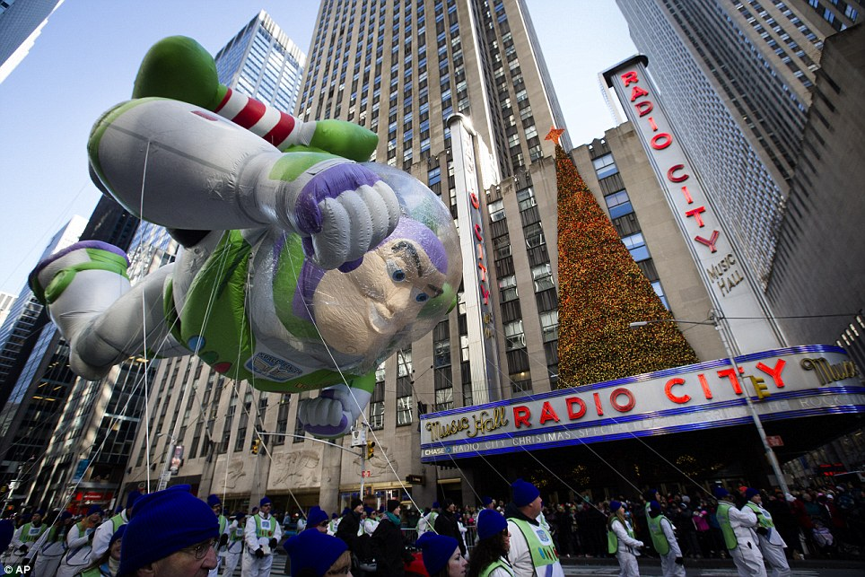 To Radio City Music Hall ...and beyond! Buzz Lightyear flies past the iconic New York concert venue