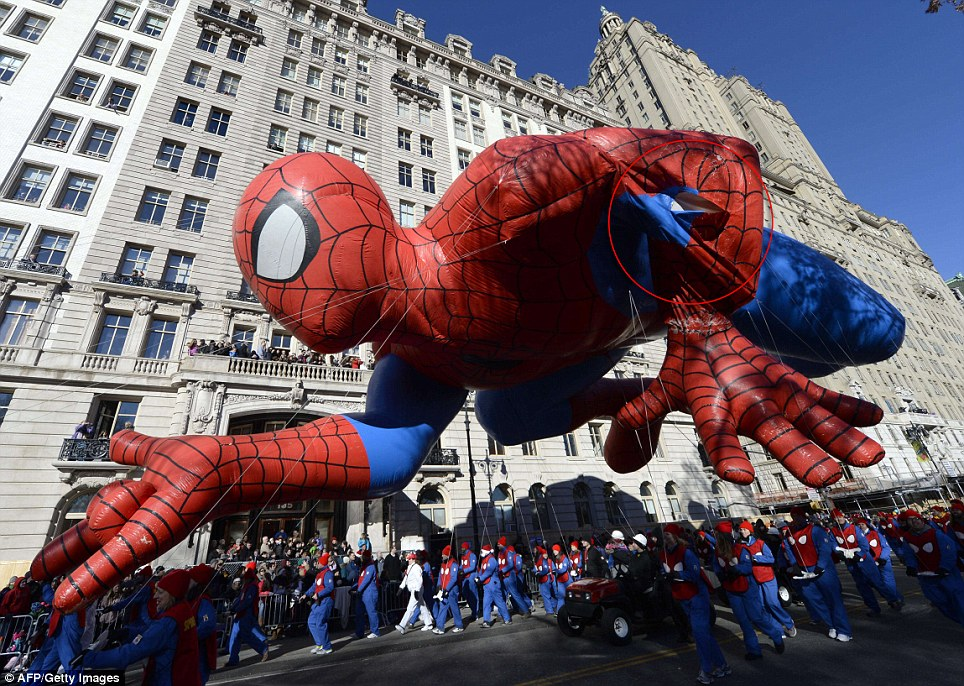 Spidey: New York's favorite superhero got caught on a tree coming down Central Park West which crippled his left hand
