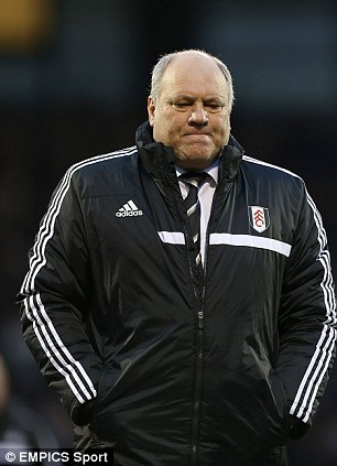 Under pressure: Fulham manager Martin Jol looks dejected