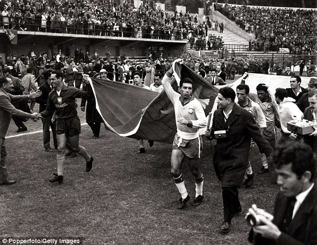Flying the flag: Nilton Santos (second right), who won the World Cup in 1958 and 1962, celebrates after Brazil beat England 3-1 in '62