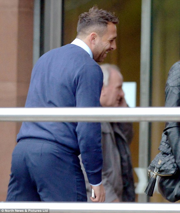 Mr Chopra smiles as he prepares to give evidence at Newcastle Crown Court