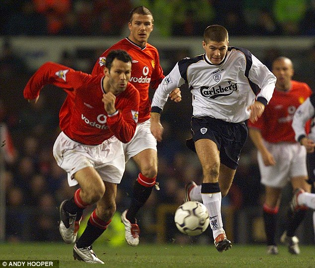 Earned respect: Giggs competes Steven Gerrard in 2002 as two of English football's fierce rivals face off