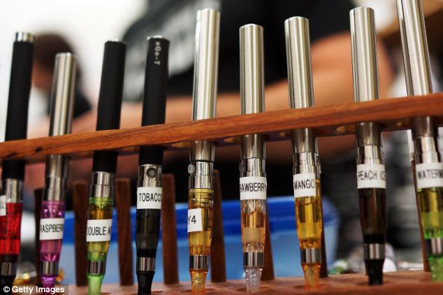 Variety: The range of flavours is one of the attributes said to be enticing young people to try e-cigarettes (file picture)