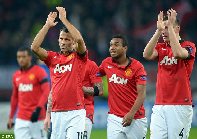 Taking the plaudits: Giggs and team-mates applaud the travelling support following their demotion of Bayer Leverkusen in the Champions League
