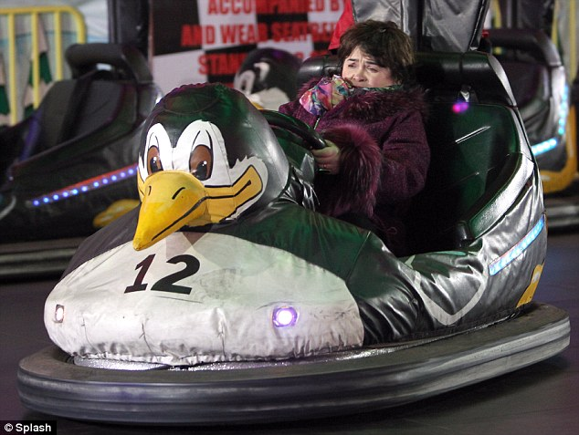 Quacking hell: Susan doesn't look too sure of herself after climbing behind the wheel of a Bumper car at Winter Wonderland
