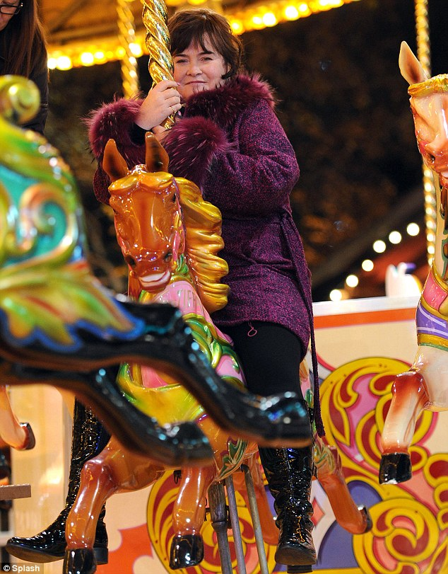 Don't mind me: Susan Boyle takes a spin on the carousel on Wednesday evening