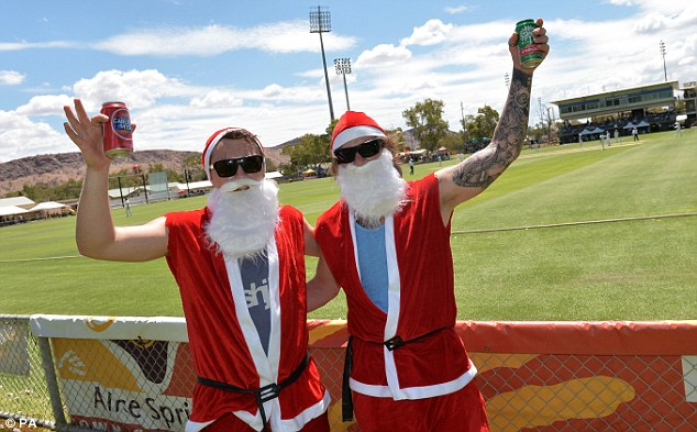 Matt finish: Prior departed after scoring 19 while two fans get into the festive spirit (below)