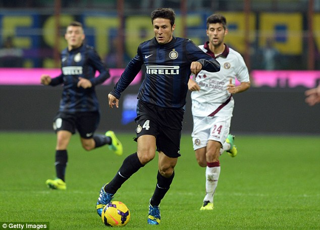 Life begins at 40: Javier Zanetti (centre), who has made over 600 Serie A appearances for Inter Milan, took to the field against Livorno