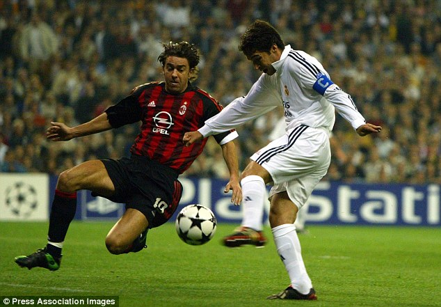 Legends of the game: Raul (right) shoots but Alessandro Costacurta is on hand to hurry the Real Madrid great