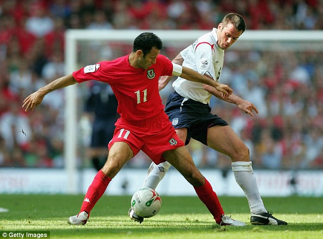 We meet again: Giggs (left) and Carragher scrap for the ball during a World Cup qualifier in 2005