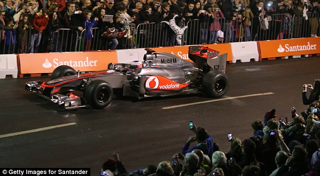 Hot wheels: Button whizzes through Frome as the assembled crowd get a close look at their hero