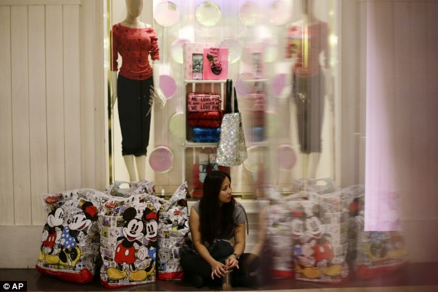 Tired out: Dorothy Santos takes a break while shopping during Black Friday at Brea Mall in California