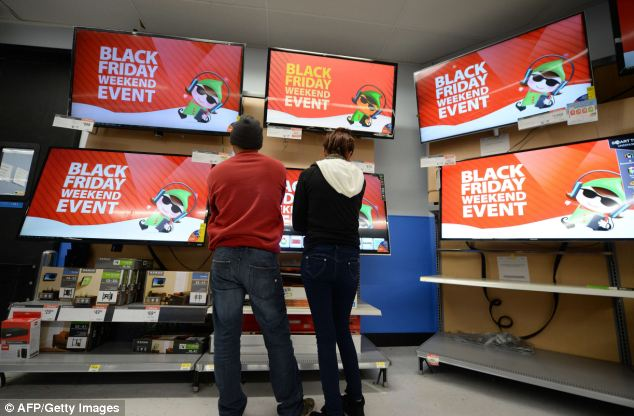 Choices: Shoppers consider televisions for sale at the Walmart in the Crenshaw district of Los Angeles