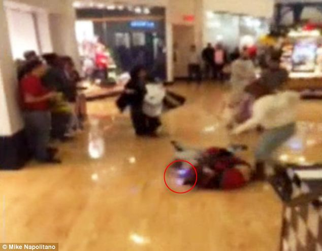 Violent: Two women can be seen fighting on the floor in a Philadelphia mall on Black Friday and one woman (left, in gray) apparently uses a stun gun on the woman in red